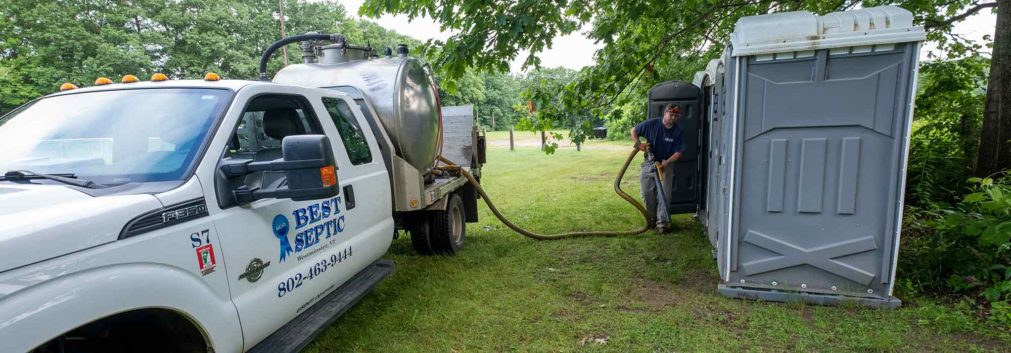 septic worker working on portable toilet