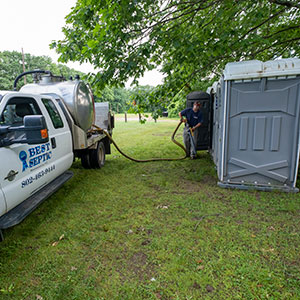 best septic worker cleaning portable toilet