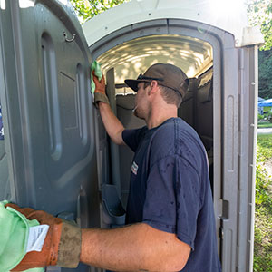 best septic worker cleaning porta potty