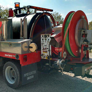 Septic Truck with long hose attached to the back.